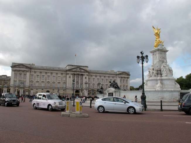 Buckingham Palace against traditionally overcast sky